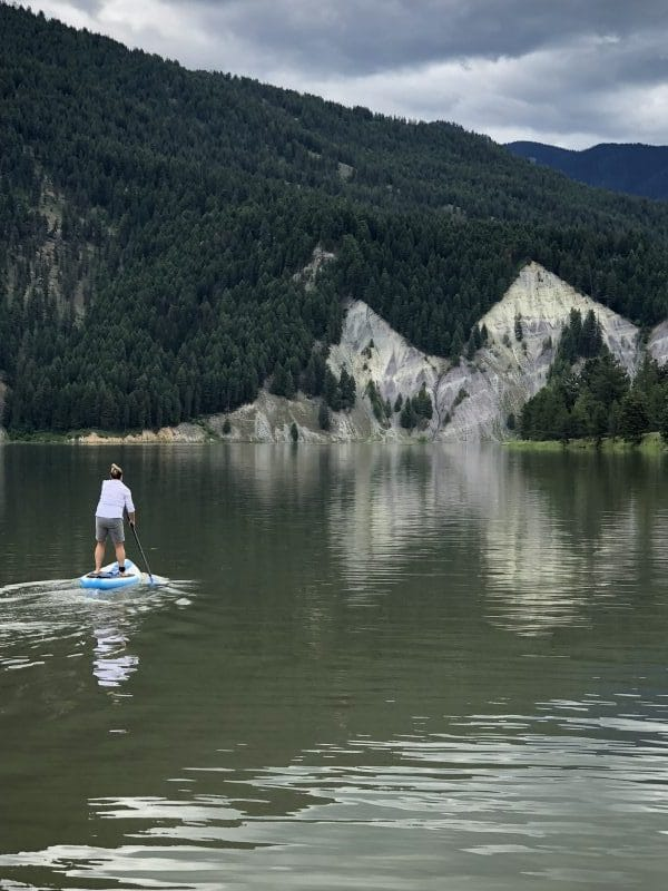 Paddling my iRocker Sport inflatable paddle board on a river in Montana