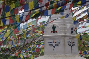 A stupa surrounded by colorful flags in Nepal