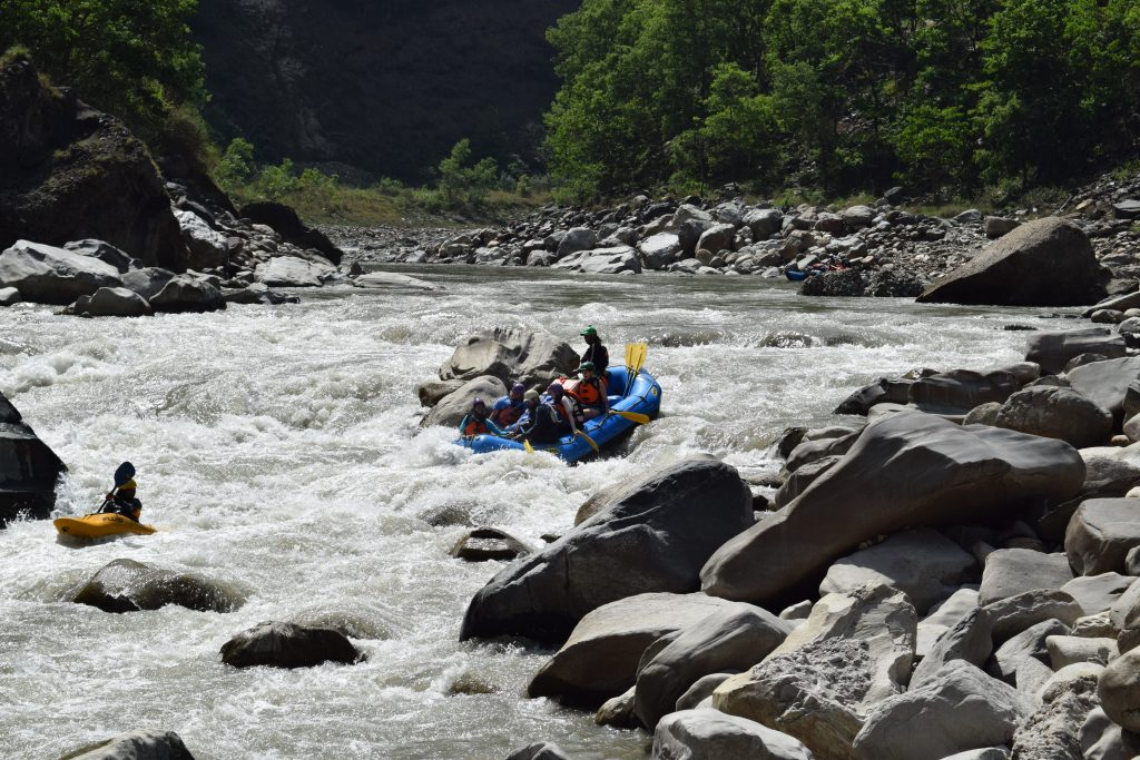 A whitewater raft navigates some rapids on one of Nepal's rivers