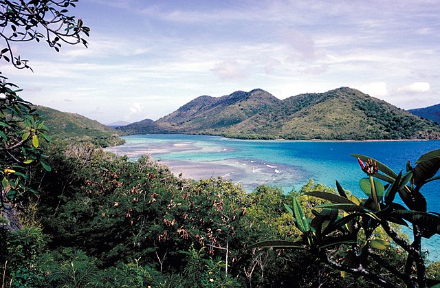 A turquoise bay is surrounded by hilly landscapes in St. John, USVI
