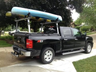 Black truck with an over-the-bed kayak rack