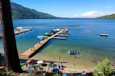 A pier with water toys juts out onto Fallen Leaf Lake