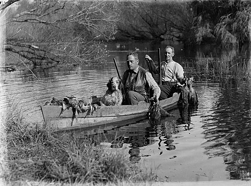 Vintage photo of duck hunters in a wooden canoe