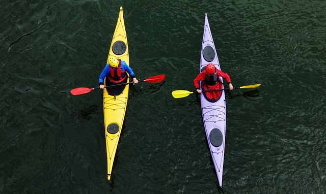 Aerial photo of two sea kayakers in long, skinny kayaks pausing for a chat