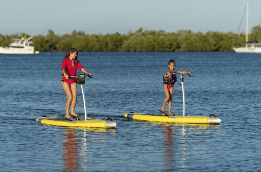 A mom and young daughter pedal side-by-side as they each try out the Hobie Mirage Eclipse.